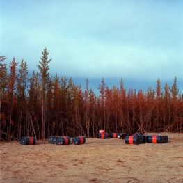Barrels of fuel lies near cleared land north of Fort McKay.