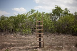 Ranchers have placed ladders like this along their fences to avoid damage made by migrants passing through their land. Often the migrants will not use the ladders for fear that they are covered with sensors.