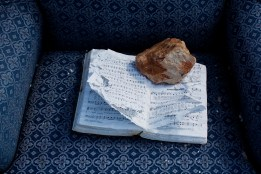 "A hymnal lays open to the song ""Amazing Grace"" and is held open by a rock at the site where a church once stood in Joplin, Missouri on June 25, 2011. When the Joplin tornado of 2011 hit the town, a wall collapsed in the church, killing several congregants."