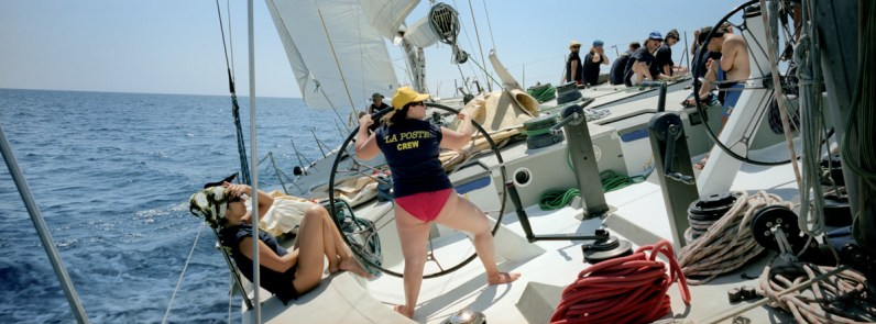 Benedetta navigates La Poste during a training session near Elba Island, Italy, 2011. Since 2006, Rome's branch of the Italian Association of People with Down syndrome is running a sailing program for young adults. Rather than being a sailing school, the program uses the boat environment to challenge the adaptive skills of its participants. In 2012 a group of the eight most proficient users were selected to join up with the official team of Mascalzone Latino to participate, on board of La Poste as a mixed crew, for the historical Barcolana sailing race. La Poste scored and amazing 24th position among more than 1000 participants.