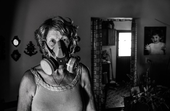 "11-18-2014, Libero, Province of Entre Ríos. Marta Elsa Cian (1947). Poultry farmer. In town, they call her ""the masked crazy woman"" because every time she leaves her home she has to wear a protective mask to avoid inhaling the continuous drifts of agrotoxins sprayed in the vicinity of her house. In 2001, she suffered exposure to multiple agrochemicals employed in soybean and rice monoculture crop farming which affected her health causing chronic respiratory failure, hypertension, neuropathies combined with hematological and cardiologic symptoms."