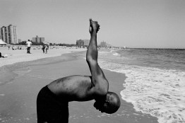 Collin Watt on the beach in Coney Island, working out. On his back, the scars left by the skin peeling off because of Tegretol when he was 12. He was given Tegretol in Queens General Hospital. Tegretol is a medicine used to cure epilepsy and it can cause strong side effects; when Collin took the medicine his skin peeled off and it took it two months hospitalized to grow again. He still carries the scars of this process. His eyes suffered a stroke of blood pressure, going blind except for a limited capability to see from the right eye. He can see colors and guess shapes in presence of a strong contrast. New York. May 13, 2012