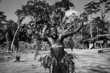 A baka pygmie man dances under the influence of alcohol in the village of Mantisone in the Dja Faunal Reserve.