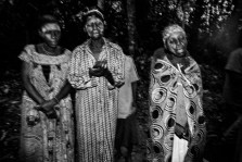 Several baka pygmie women sing at dawn in a ceremony to attract animals for hunting and fishing. Village of Bosquet, Dja Faunal Reserve in Cameroon.