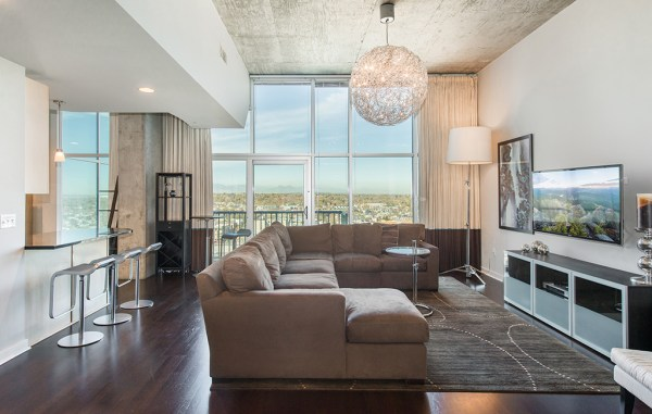 The apartment is part of the Glass House complex, named for its floor-to-ceiling windows overlooking LoHi, the Rockies and the South Platte. (Courtesy LIV Sotheby's)
