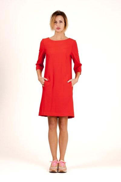A-line dress in poppy red. Pockets in side seam. By Barbara van der Zanden