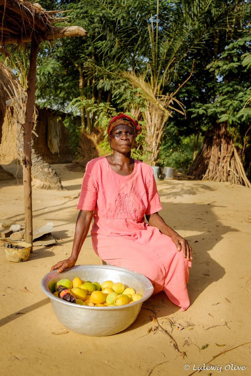 proud woman with fruit in Atsiekpoe, Ghana