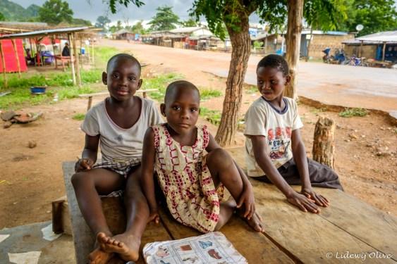 three kids at a shop at the road, Ghana