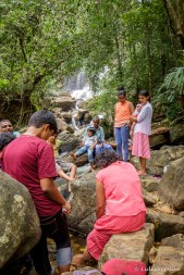 Locals enjoying the waterfall and fish massage