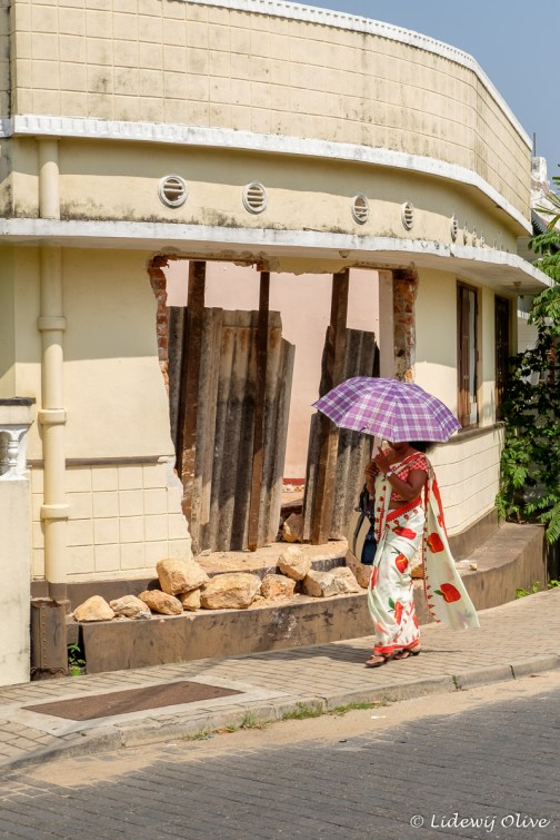 A lot of people in Sri Lanka use an umbrella to prevent the heat