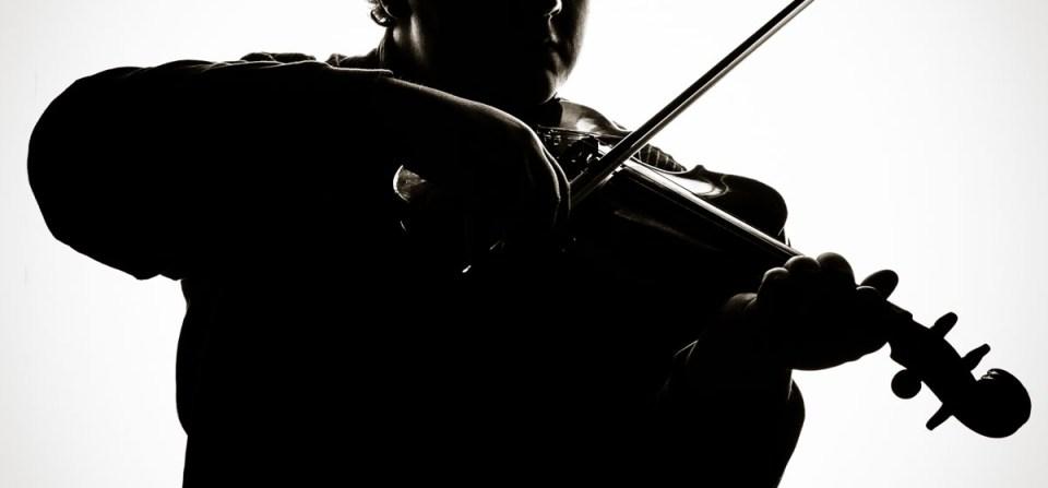 Thomas playing the violin