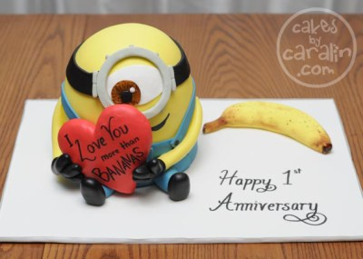 Minion in love cake. 3D Minion with a banana and a heart.