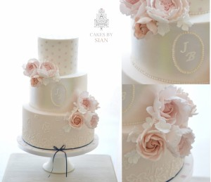 Blush pink and navy wedding cake