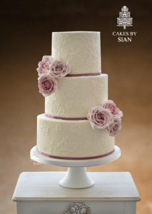 lace wedding cake with mauve roses
