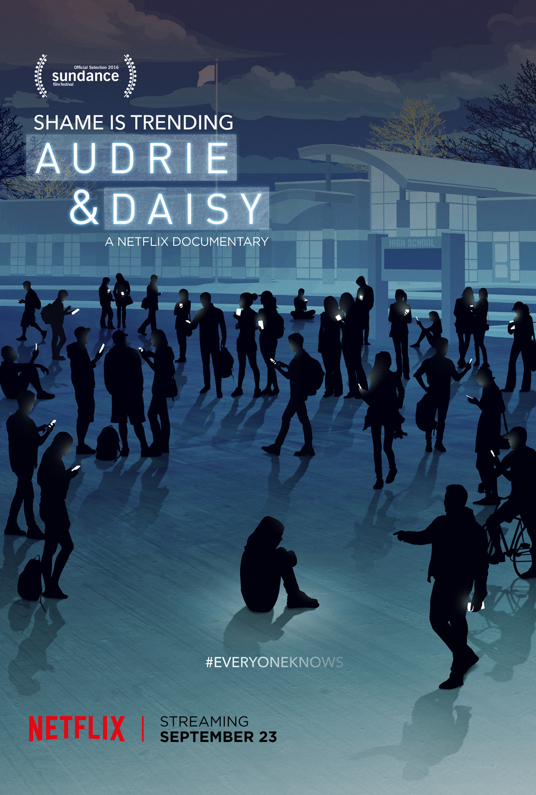 Audrie & Daisy movie poster showing people in front of a high school campus on their cell phones surrounding a person sitting on the ground