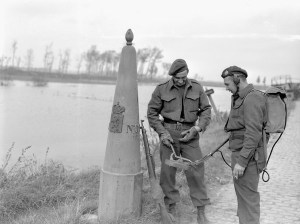 Sappers of the Royal Canadian Engineers (R.C.E.), 3rd Canadian Infantry Division, sweeping for mines along the border between Belgium and the Netherlands, 16 October 1944.