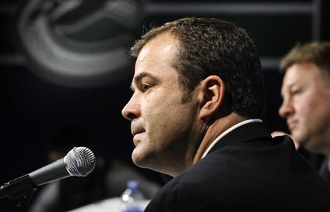 Alain Vigneault and Mike Gillis