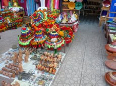 Colorful display at the market - sous seller's hats and more trinkets