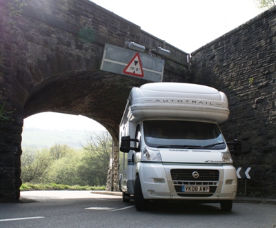 Motorhome driving under low bridge