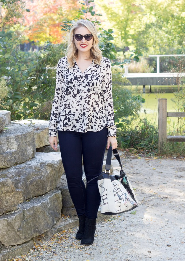 A fall outfit wearing a Vince spotted blouse and seven jeans
