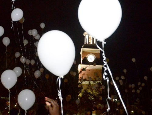 File Photo by Jacob Moore  Homicide-loss survivors release white balloons at the end of the  Remember Me Commemorative Walk.