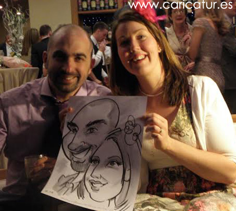 Wedding guests in Lough Rynn castle with caricature by Allan Cavanagh
