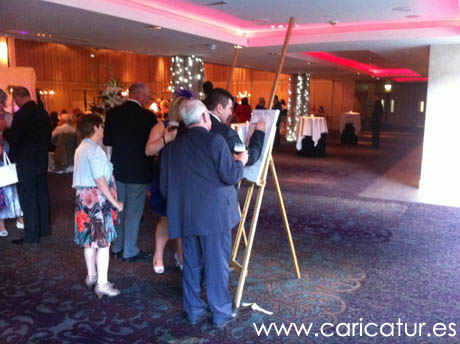 wedding guests signing guestbook signing board at wedding in Limerick with caricature by Allan Cavanagh