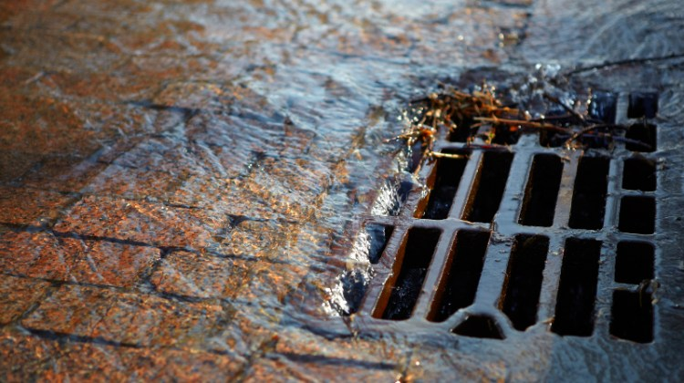 Water going down sewer, city water, water runoff, gutter, sewer