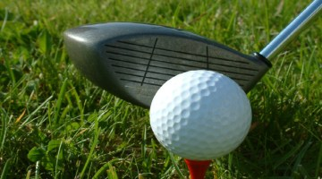Golf, tee, teeing off, charity, donation, event, golfing, golf course, driver, golf ball, tee box.