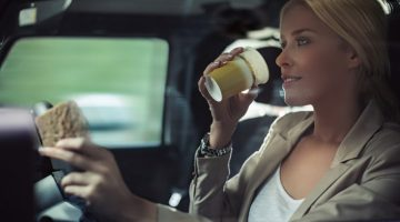 woman, car, driving, coffee, coffee cup, driving with coffee, sandwich