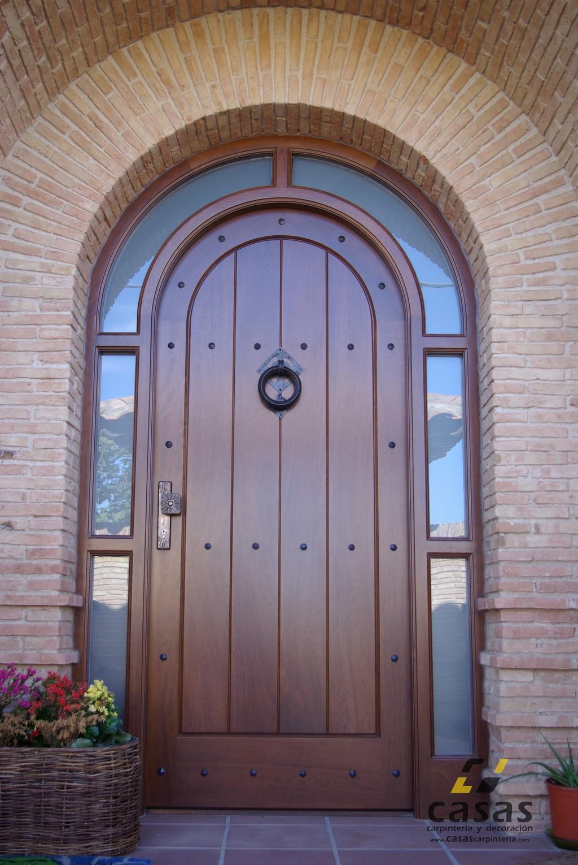 Casas carpinter a y decoraci n puertas de madera casas for Arcos de madera para puertas