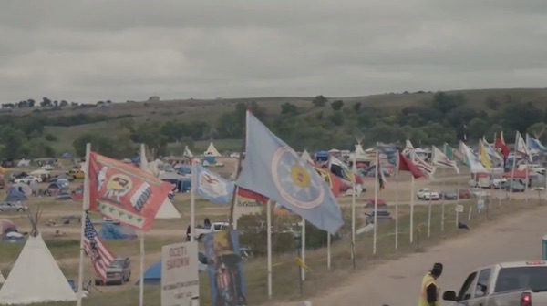 'We are power': Native nations' flags fly united at the Standing Rock Sioux encampment against the Dakota Access oil pipeline.