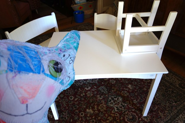 Whimsical Cat Doll selfie with children's table.