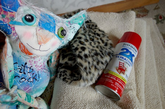 The Chairman poses with high-end sheepskin fabric, a flubby animal print and a can of red glossy spray paint.