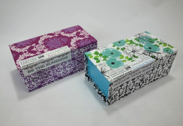 Two beautiful single soap boxes. One is a damask design. The other is abstract floral.