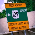 Road sign: Truck Advisory. US 129 South. Switchback curves ahead. Consider alternate route