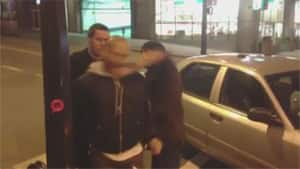 A still from a video posted to Facebook shows a plainclothes Vancouver police officer with a fist apparently making contact with the jaw of a detained cyclist.