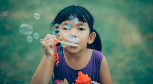 Parenting Truths About Raising An Only Child   Learning Little girl blowing bubbles