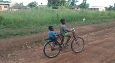Small boys on a big bike