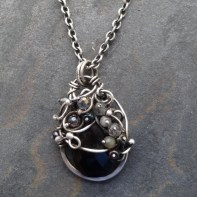 Black Onyx Sterling Silver wrapped pendant 45mm long