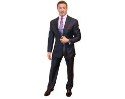 A Lifesize Cardboard Cutout of Sylvester Stallone wearing a suit