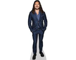 A Lifesize Cardboard Cutout of Luke Arnold wearing a suit