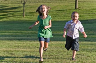 Kids Running Through Park