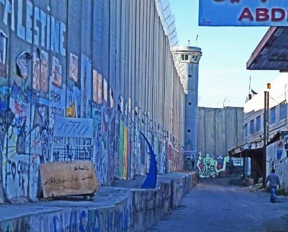 Security wall in Israel murals man walking
