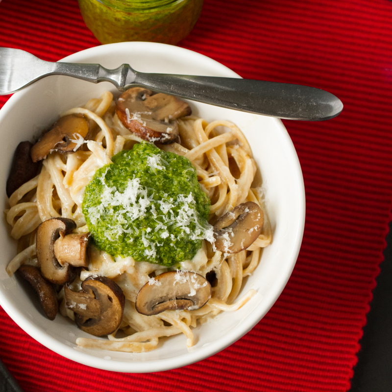 Alfredo linguine with arugula pesto and mushrooms is a simple, delicious dinner that comes together in less than thirty minutes. | recipe from Chattavore.com