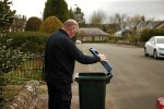 Bob Douglas, Evening Telegraph. Pictured in Longforgan, a resident checking his Perth & Kinross recycling bin. Words by Connor.