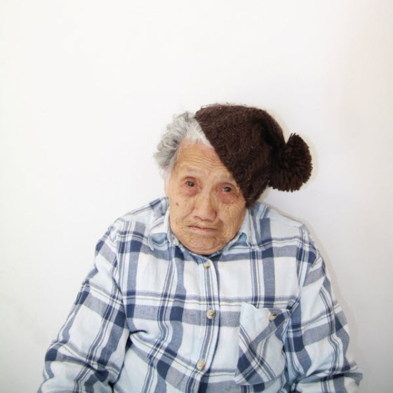 Crazy Chinese granny wearing a brown cap on her head.