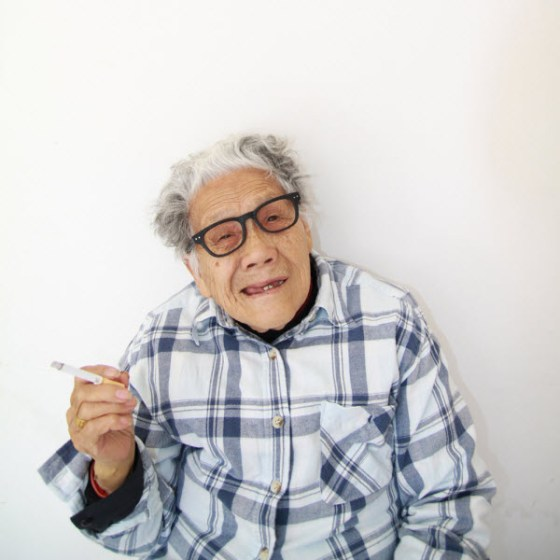 Crazy Chinese granny smoking a cigarette.