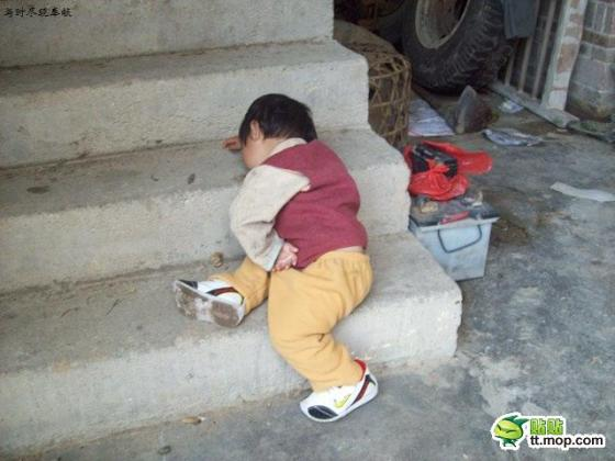 Chinese toddler asleep on the stairs.