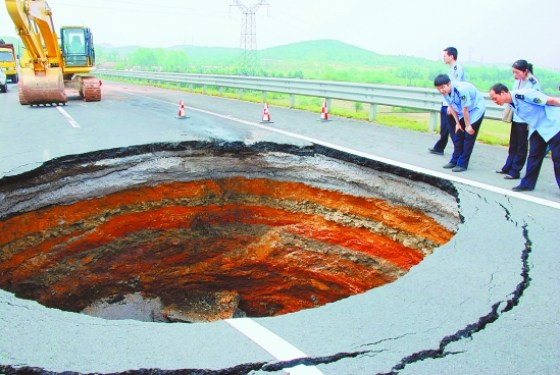 A sinkhole in the middle of a road in China.